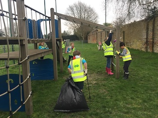 Image children cleaning playground