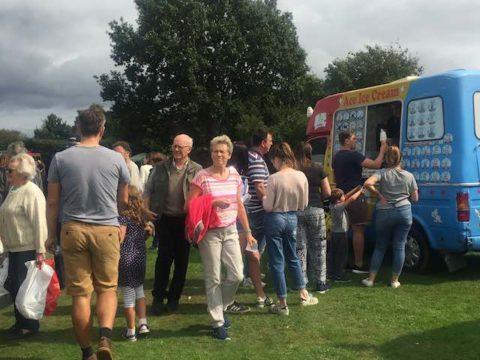 Image of people and icecream van