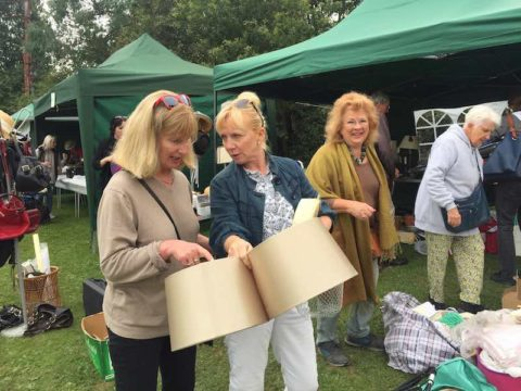 Image of three women at Fete