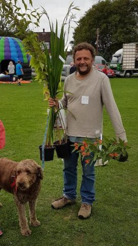 Image Julian Kenny with plants and dog